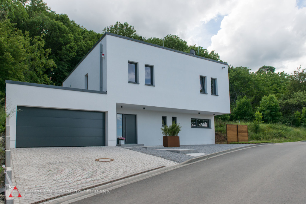 Modernes Tonnendachhaus